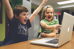 children celebrating at laptop screen